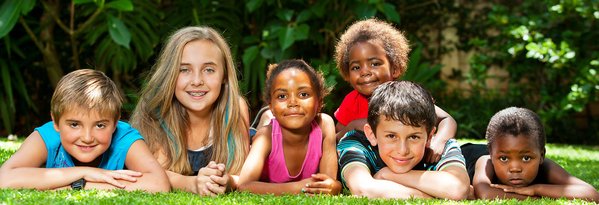 Kids laying in grass - Pediatric Dentist in Ann Arbor, MI